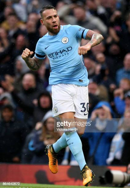 Nicolas Otamendi of Manchester City celebrates scoring his side's second goal during the Premier League match between Manchester City and Burnley at...