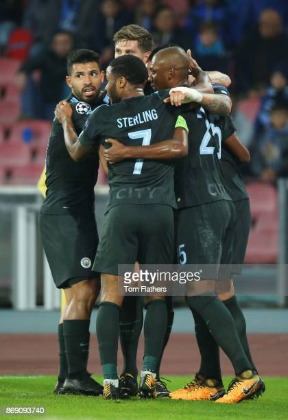 Nicolas Otamendi of Manchester City celebrates scoring his sides first goal with his Manchester City team mates during the UEFA Champions League...