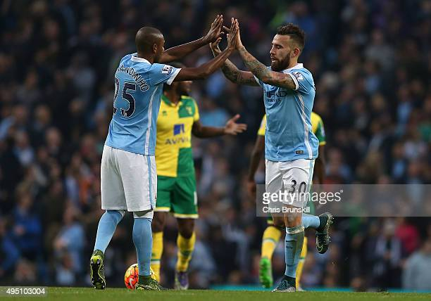 Nicolas Otamendi of Manchester City celebrates scoring his team's first goal with his tema mate Fernandinho during the Barclays Premier League match...