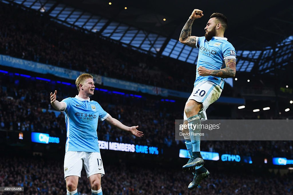 Nicolas Otamendi (R) of Manchester City celebrates scoring his team's first goal with his team mate Kevin de Bruyne (L) during the Barclays Premier League match between Manchester City and Norwich City at Etihad Stadium on October 31, 2015 in Manchester, England.