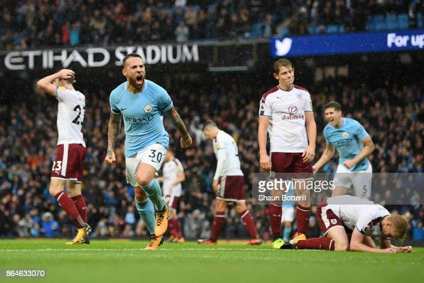 Nicolas Otamendi of Manchester City celebrates scoring the 2nd Manchester City goal during the Premier League match between Manchester City and...