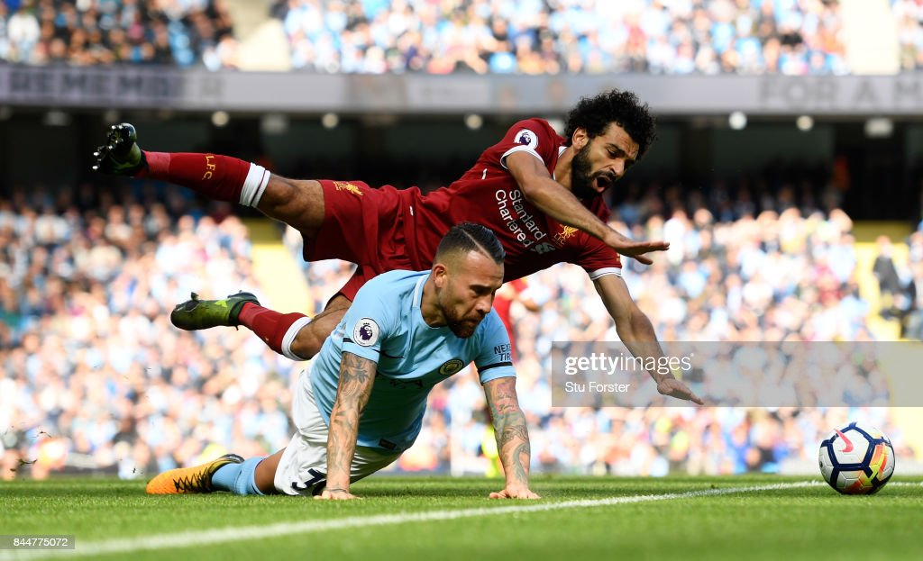 Nicolas Otamendi of Manchester City fouls Mohamed Salah of Liverpool during the Premier League match between Manchester City and Liverpool at Etihad Stadium on September 9, 2017 in Manchester, England.