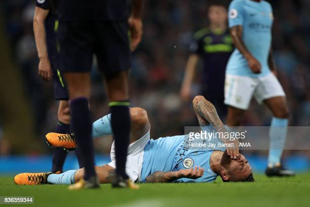Nicolas Otamendi of Manchester City goes down after a challenge during the Premier League match between Manchester City and Everton at Etihad Stadium...