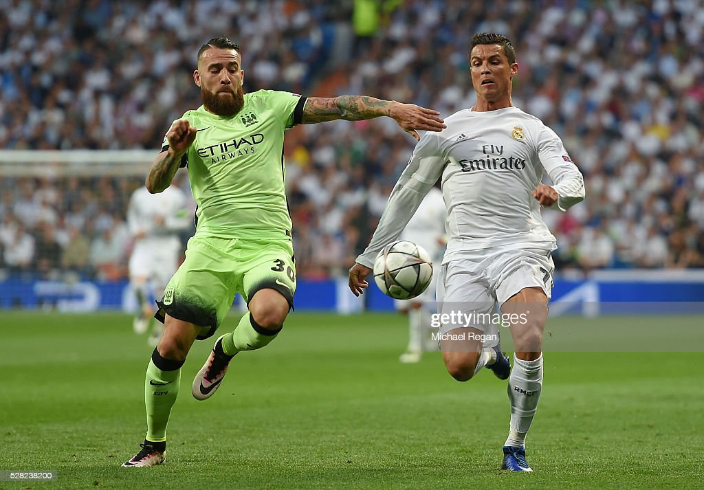 <a gi-track='captionPersonalityLinkClicked' href=/galleries/search?phrase=Nicolas+Otamendi&family=editorial&specificpeople=5863368 ng-click='$event.stopPropagation()'>Nicolas Otamendi</a> of Manchester City holds off the challenge from <a gi-track='captionPersonalityLinkClicked' href=/galleries/search?phrase=Cristiano+Ronaldo+-+Fotbollsspelare&family=editorial&specificpeople=162689 ng-click='$event.stopPropagation()'>Cristiano Ronaldo</a> of Real Madrid during the UEFA Champions League semi final, second leg match between Real Madrid and Manchester City FC at Estadio Santiago Bernabeu on May 4, 2016 in Madrid, Spain.