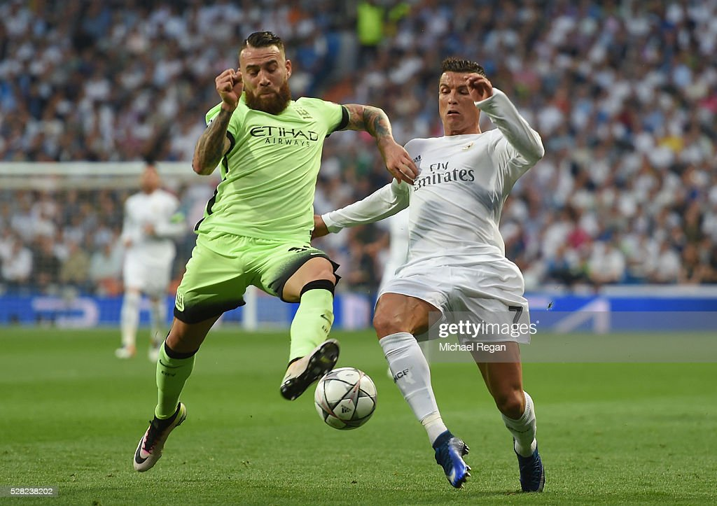 Nicolas Otamendi of Manchester City holds off the challenge from <a gi-track='captionPersonalityLinkClicked' href=/galleries/search?phrase=Cristiano+Ronaldo+-+Calciatore&family=editorial&specificpeople=162689 ng-click='$event.stopPropagation()'>Cristiano Ronaldo</a> of Real Madrid during the UEFA Champions League semi final, second leg match between Real Madrid and Manchester City FC at Estadio Santiago Bernabeu on May 4, 2016 in Madrid, Spain.