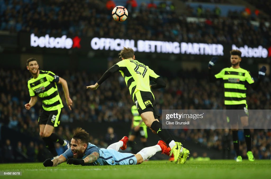 Nicolas Otamendi of Manchester City (grounded) is fouled by Jon Gorenc Stankovic of Huddersfield Town (27) for a penalty during The Emirates FA Cup Fifth Round Replay match between Manchester City and Huddersfield Town at Etihad Stadium on March 1, 2017 in Manchester, England.
