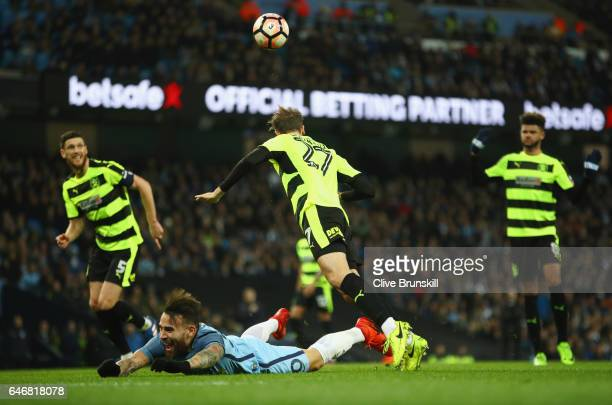 Nicolas Otamendi of Manchester City is fouled by Jon Gorenc Stankovic of Huddersfield Town for a penalty during The Emirates FA Cup Fifth Round...