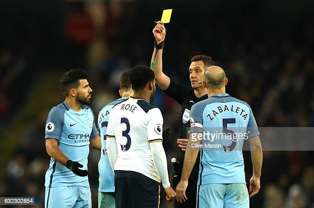 Nicolas Otamendi of Manchester City is shown a yellow card by referee Andre Marriner during the Premier League match between Manchester City and...