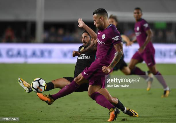 Nicolas Otamendi of Manchester City kicks the ball away from Francisco Alarcon of Real Madrid during the International Champions Cup match between...