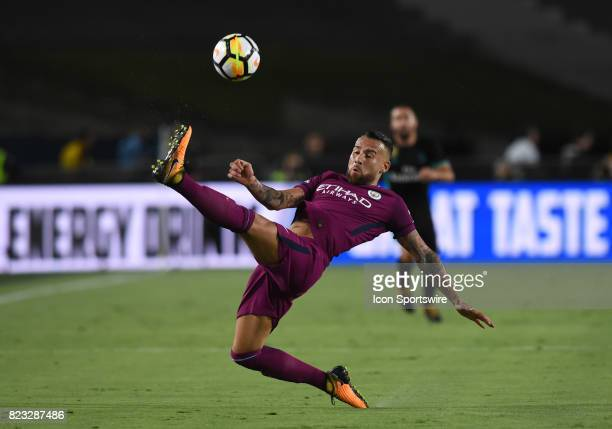 Nicolas Otamendi of Manchester City leaps and kicks the ball while in the air during the International Champions Cup match between Real Madrid and...