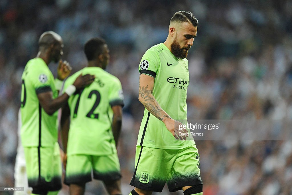 Nicolas Otamendi of Manchester City looks dejected during the UEFA Champions League semi final, second leg match between Real Madrid and Manchester City FC at Estadio Santiago Bernabeu on May 4, 2016 in Madrid, Spain.