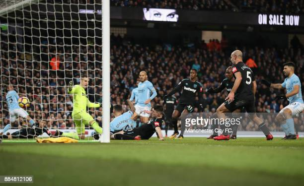 Nicolas Otamendi of Manchester City scores his sides first goal during the Premier League match between Manchester City and West Ham United at Etihad...