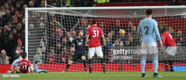 Nicolas Otamendi of Manchester City scores their second goal during the Premier League match between Manchester United and Manchester City at Old...