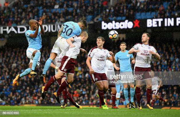 Nicolas Otamendi of Manchester City scores their second goal with a header during the Premier League match between Manchester City and Burnley at...