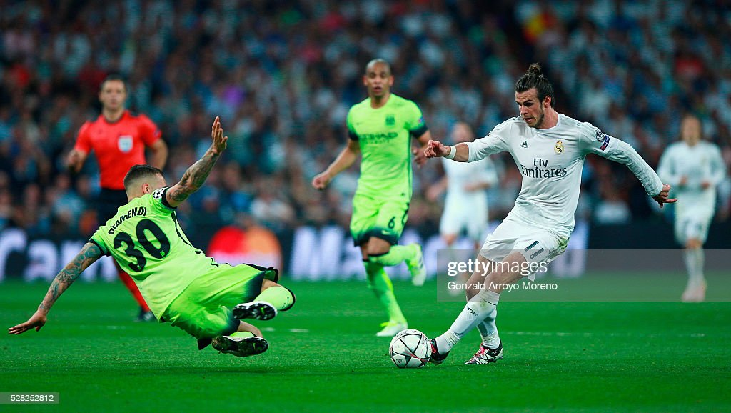 http://media.gettyimages.com/photos/nicolas-otamendi-of-manchester-city-tackles-gareth-bale-of-real-the-picture-id528252812