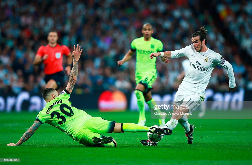 Nicolas Otamendi of Manchester City tackles Gareth Bale of Real Madrid during the UEFA Champions League semi final, second leg match between Real Madrid and Manchester City FC at Estadio Santiago Bernabeu on May 4, 2016 in Madrid, Spain.