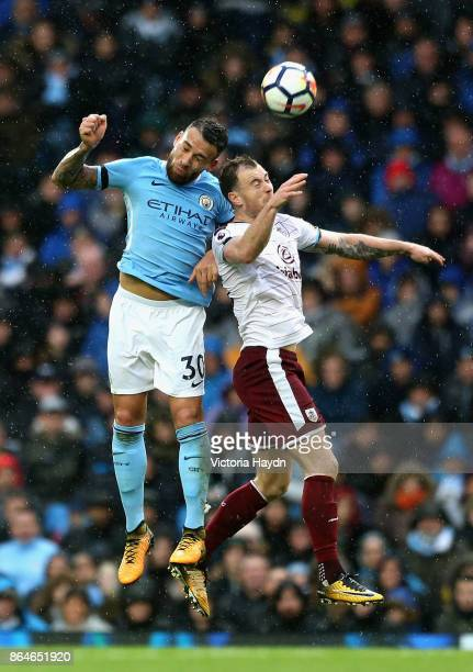 Nicolas Otamendi of Manchester City wins a a header during the Premier League match between Manchester City and Burnley at Etihad Stadium on October...