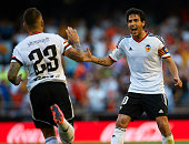 Nicolas Otamendi of Valencia celebrates after scoring with his teammate Dani Parejo during the La Liga match between Valencia CF and Celta de Vigo at...
