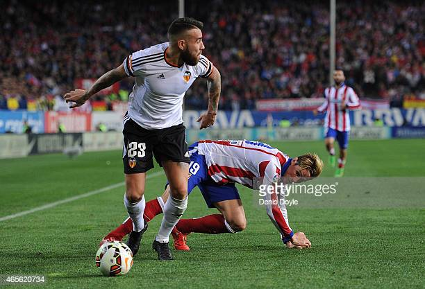 Nicolas Otamendi of Valencia CF gets the better of Fernando Torres of Club Atletico de Madrid goes for a high ball against during the Lia Liga match...