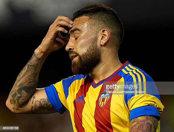 Nicolas Otamendi of Valencia reacts as he fails to score during the preseason friendly match between Valencia CF and AS Roma at Estadio Mestalla on...