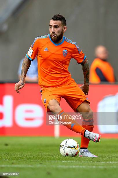 Nicolas Otamendi of Valencia runs with the ball during the Colonia Cup 2015 match between FC Valencia and FC Porto at RheinEnergieStadion on August 1...