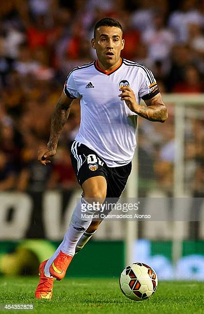 Nicolas Otamendi of Valencia runs with the ball during the La Liga match between Valencia CF and Malaga CF at Estadi de Mestalla on August 29 2014 in...