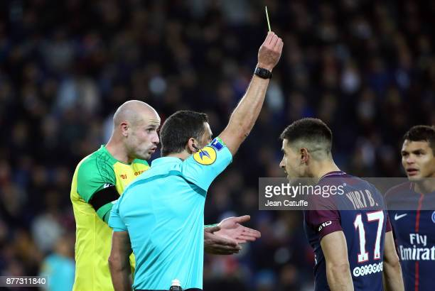 Nicolas Pallois of FC Nantes and Yuri Berchiche of PSG both receives a yellow card from referee Nicolas Rainville during the French Ligue 1 match...
