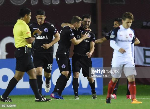 Nicolas Pasquini of Lanus celebrates with teammates after scoring the second goal of his team during the second leg match between Lanus and San...