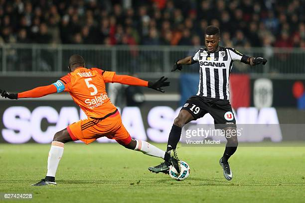 Nicolas Pepe of Angers and Zarko Toure of Lorient during the Ligue 1 match between Angers SCO and FC Lorient on December 3 2016 in Angers France