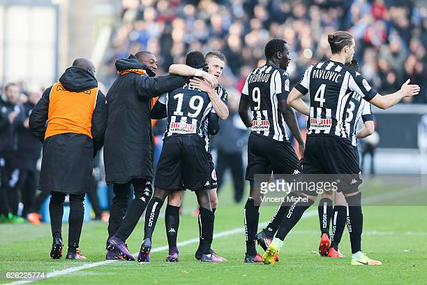 Nicolas Pepe of Angers jubilates with teammates after scoring the first goal during the French Ligue 1 match between Angers and Saint Etienne on...