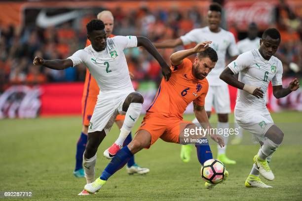 Nicolas Pepe of Ivory Coast Kevin Strootman of The Netherlands Jean Michel Seri of Ivory Coastduring the friendly match between The Netherlands and...