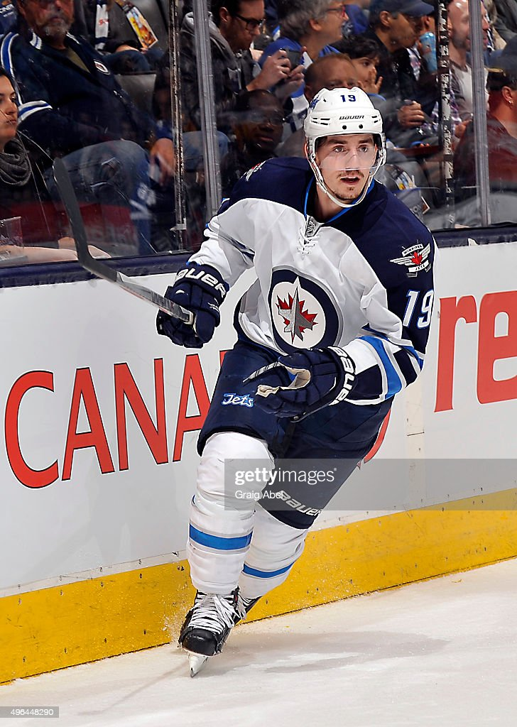 <a gi-track='captionPersonalityLinkClicked' href=/galleries/search?phrase=Nicolas+Petan&family=editorial&specificpeople=10122406 ng-click='$event.stopPropagation()'>Nicolas Petan</a> #19 of the Winnipeg Jets turns up ice against the Toronto Maple Leafs during game action on November 4, 2015 at Air Canada Centre in Toronto, Ontario, Canada.