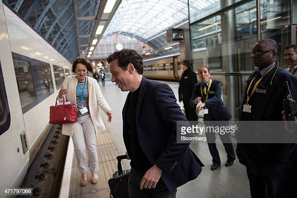 Nicolas Petrovic chief executive officer of Eurostar International Ltd center rushes to board a Eurostar train as a new service linking London with...