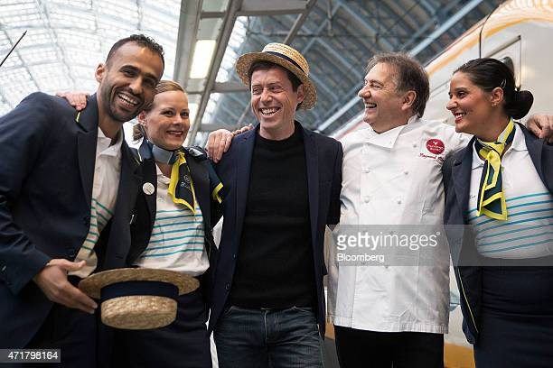 Nicolas Petrovic chief executive officer of Eurostar International Ltd center and Raymond Blanc a Michelinstarred chef second right pose for a...