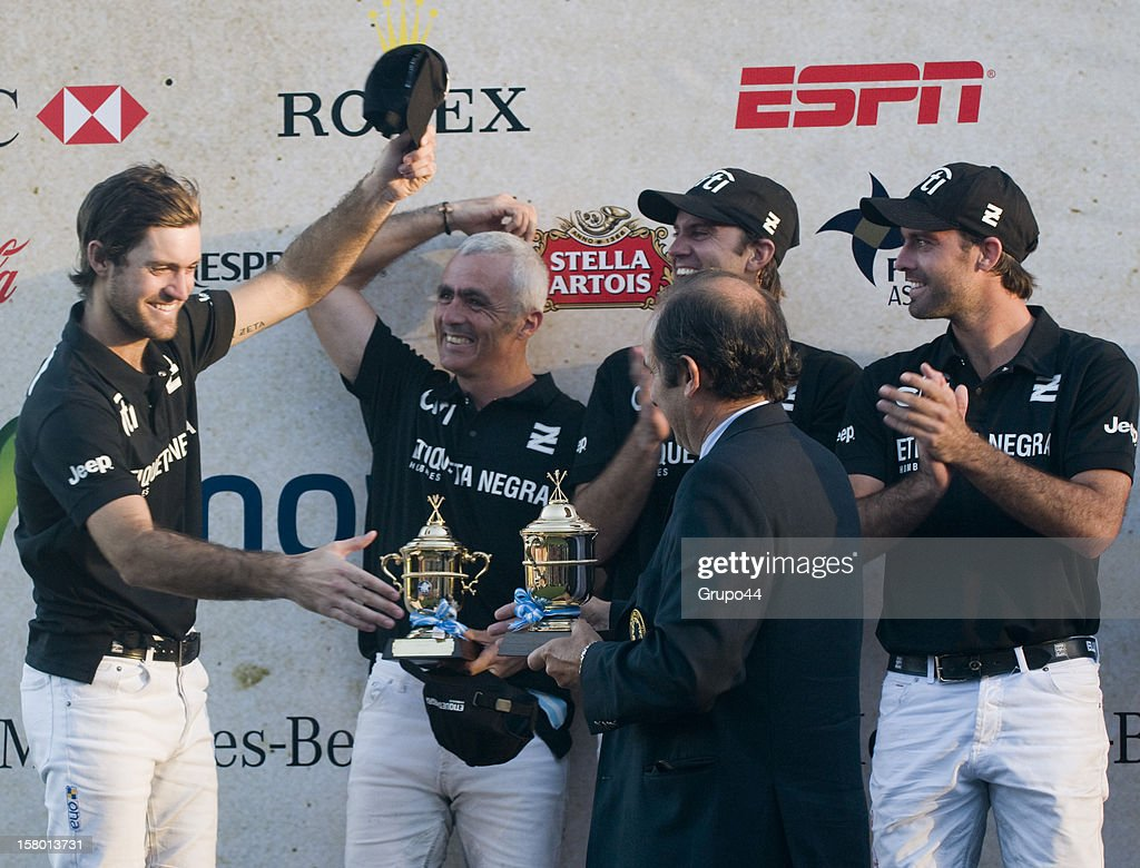 Nicolas Pieres, Mariano Aguerre, Gonzalo Pieres and Facundo Pieres receive trophies from the presiden of the Polo Asociation of Argentina Luis Lalor after a polo match between La Dolfina and Ellerstina as part of the 119th Argentina Open Polo Championship Final on December 08, 2012 in Buenos Aires, Argentina.