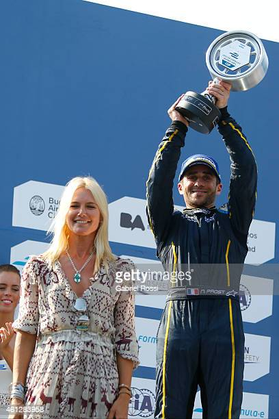 Nicolas Prost of France and edams Renault Formula E Team celebrates with the trophy at the podium next to Argentinian model Valeria Mazza after...
