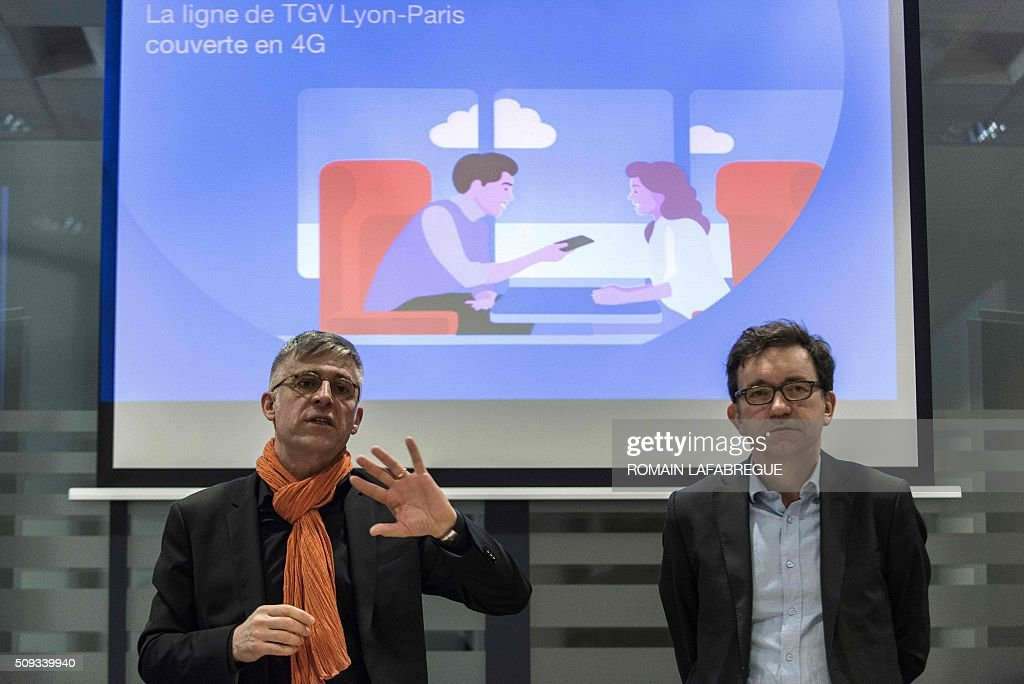 Nicolas Roy (R), CTO for networks and services at French telecommunications corporation Orange, and Olivier Faure, director of Orange's East Center, deliver a press conference at Orange's mobile phone supervision center in Lyon on February 10, 2016. / AFP / ROMAIN LAFABREGUE