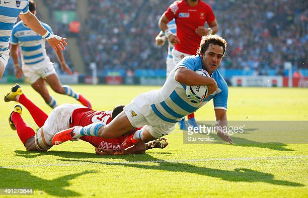 Nicolas Sanchez of Argentina dives over for their third try during the 2015 Rugby World Cup Pool C match between Argentina and Tonga at Leicester...