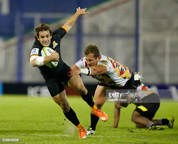 Nicolas Sanchez of Jaguaresis tackled by Schalk Ferreira of Kings during a match between Jaguares and Kings as part of Super Rugby 2016 6 at Jose...