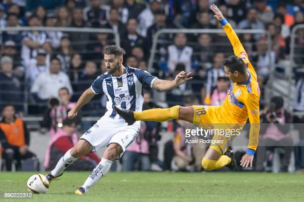 Nicolas Sanchez of Monterrey fights for the ball with Ismael Sosa of Tigres during the second leg of the Torneo Apertura 2017 Liga MX final between...