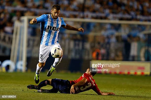 Nicolas Sanchez of Racing Club and Nicolas Tagliafico of Independiente fight for the ball during a match between Racing Club and Independiente as...