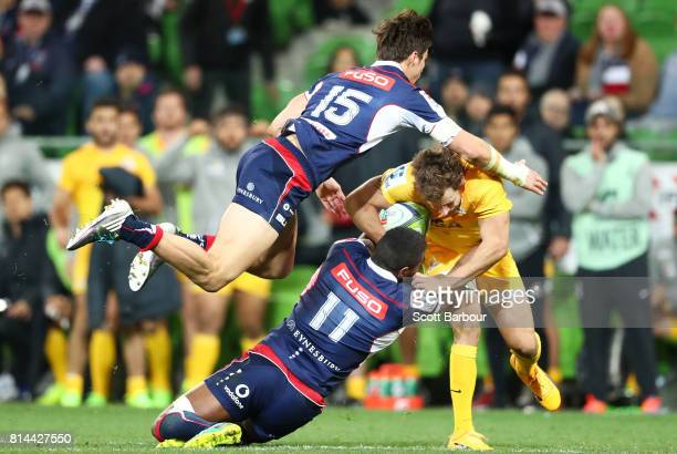 Nicolas Sanchez of the Jaguares is tackled by Jack Maddocks of the Rebels during the round 17 Super Rugby match between the Melbourne Rebels and the...