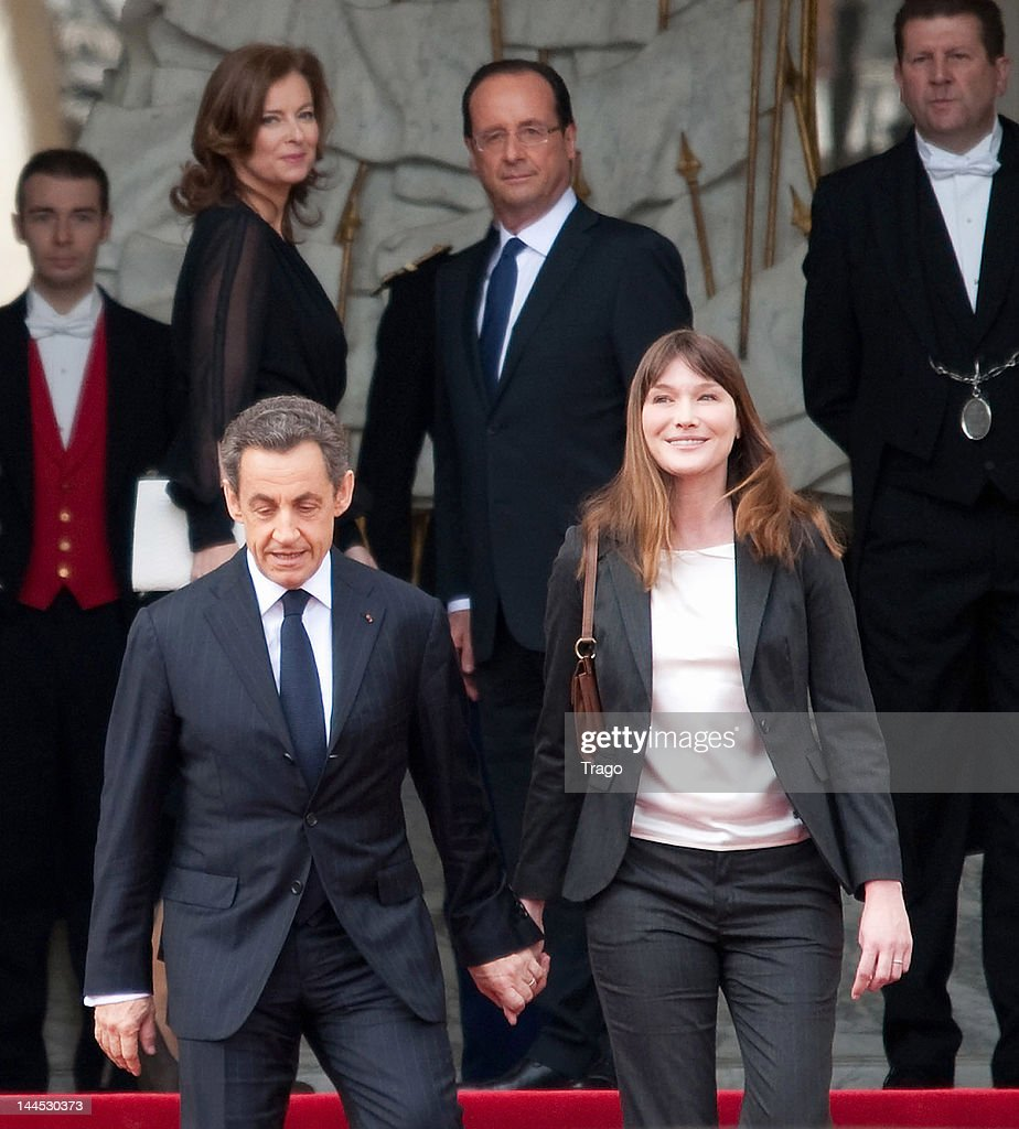 Nicolas Sarkozy and Carla Bruni leave the Elysee Palace after Francois Hollande was sworn in as President, as the French President and his partner Valerie Trierweiler look on (rear), on May 15, 2012 in Paris, France. While Sarkozy has suggested that he will leave politics to return to a career in law, Francois Hollande will name his cabinet and travel to Germany for talks with German Chancellor Angela Merkel within hours of his inauguration.