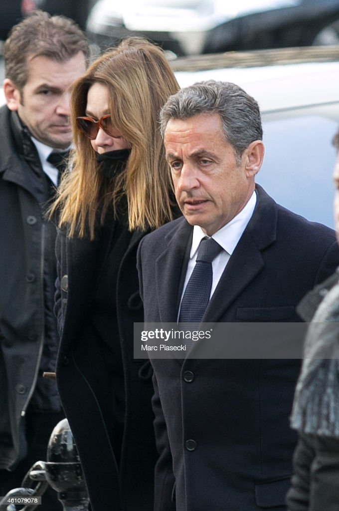 Nicolas Sarkozy and wife Carla Bruni-Sarkozy arrive to attend the funeral of journalist Jacques Chancel at Saint-Germain-des-Pres church on January 6, 2015 in Paris, France.