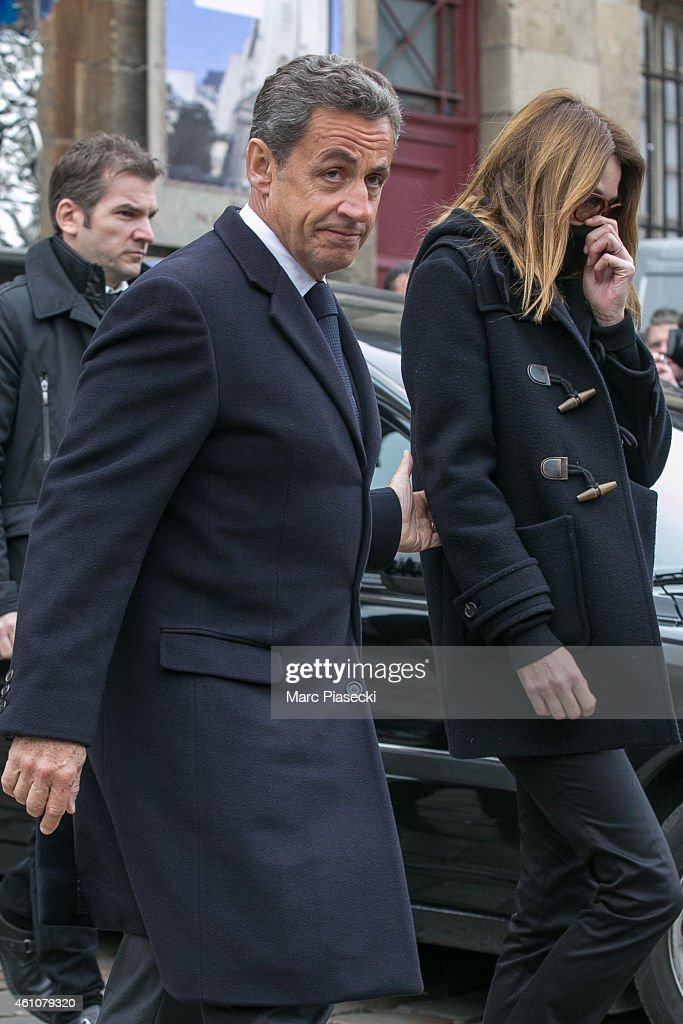 Nicolas Sarkozy and wife Carla Bruni-Sarkozy leave the funeral of Jacques Chancel at Saint-Germain-des-Pres church on January 6, 2015 in Paris, France.
