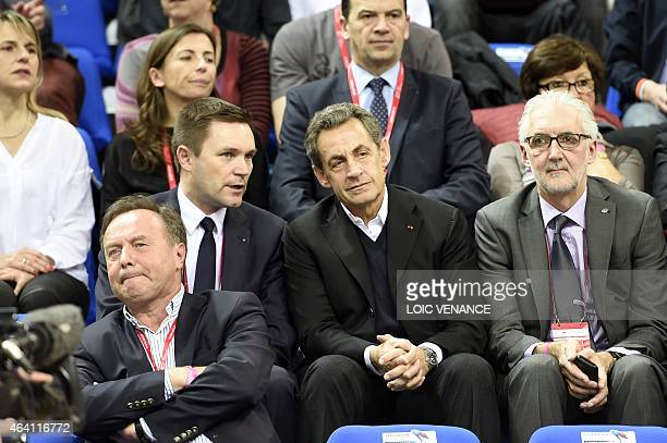 Nicolas Sarkozy former French president and head of the French rightwing opposition UMP party sits next to UCI President Brian Cookson and President...
