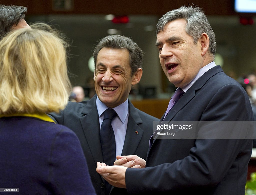 Nicolas Sarkozy, France's president, center, gestures as Gordon Brown, U.K. prime minister, right, speaks as EU leaders gather for the European Union Summit in Brussels, Belgium, on Friday, March 26, 2010. Sarkozy capped a week of reversals with his acceptance of German demands on a contingency plan to aid Greece. Photographer: Jock Fistick/Bloomberg via Getty Images