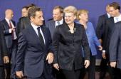 Nicolas Sarkozy France's president left and Dalia Grybauskaite Lithuania's president leave after the family photograph of European Union leader's...