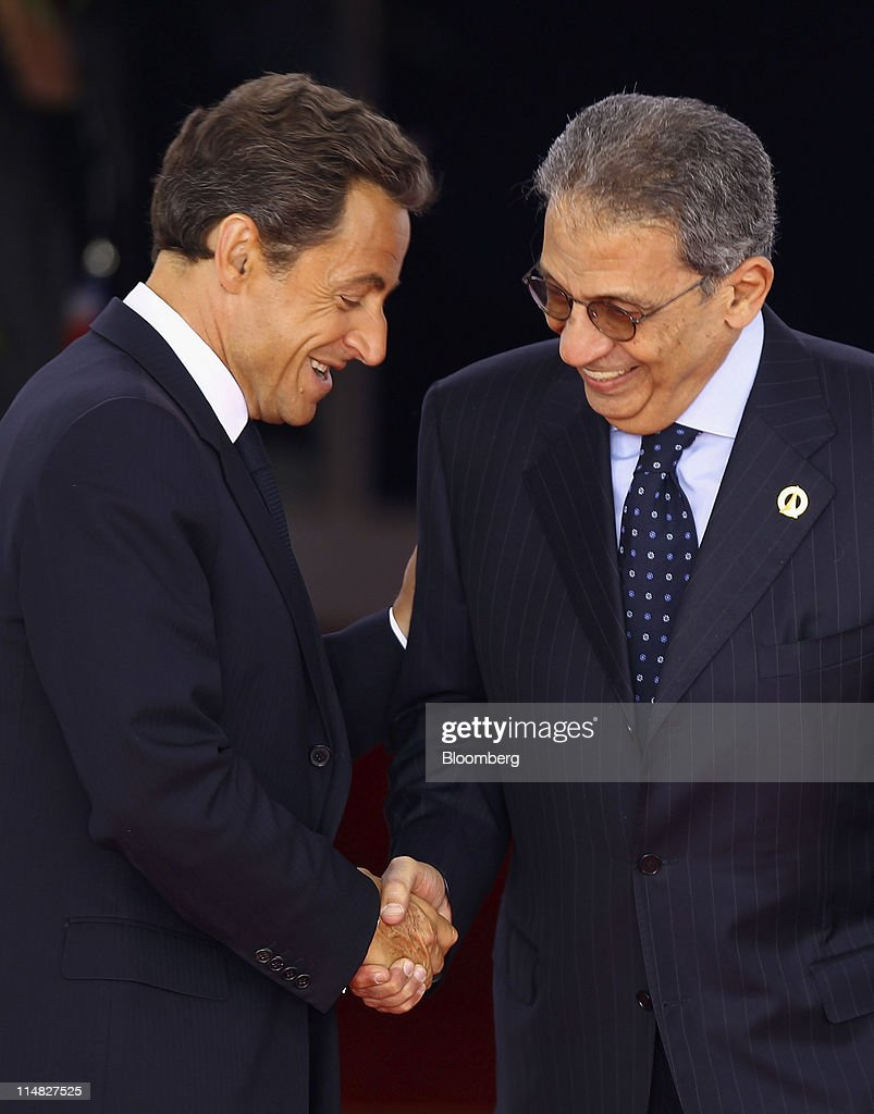 <a gi-track='captionPersonalityLinkClicked' href=/galleries/search?phrase=Nicolas+Sarkozy&family=editorial&specificpeople=211375 ng-click='$event.stopPropagation()'>Nicolas Sarkozy</a>, France's president, left, shakes hands with Amre Moussa, secretary-general of the Arab League, during the Group of Eight (G8) summit in Deauville, France, on Friday, May 27, 2011. Group of Eight leaders said a strengthening global economy will pave the way to cuts in the debt built up in the recession that followed the 2008 financial crisis. Photographer: Jeff J. Mitchell/Pool via Bloomberg via Getty Images