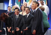Nicolas Sarkozy France's president with Hu Jintao China's president and US President Barack Obama join other leaders of the Group of 20 countires for...